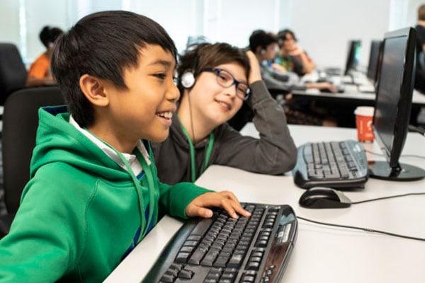 young boy at computer