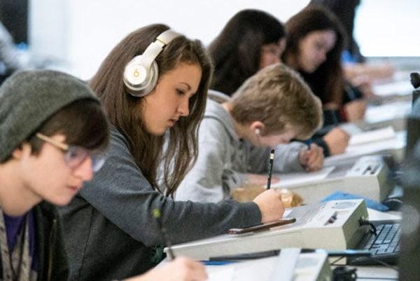 teen students learning digitally