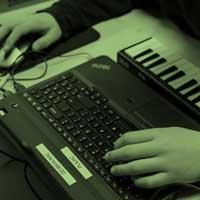 teen learning digital music for film